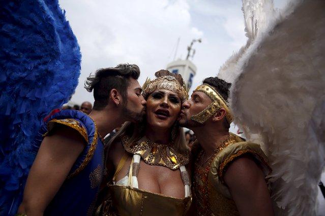 Revellers take part in the LGBT Pride Parade in Copacabana beach in Rio de Janeiro, Brazil, November 15, 2015. (Photo by Pilar Olivares/Reuters)