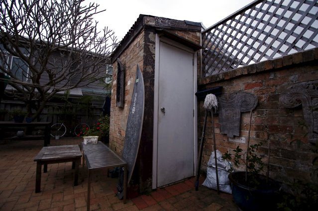 A surfboard rests against an old toilet shed, also known in Australia as a 'dunny' or an 'outhouse', in the backyard of a home in the northern beaches suburb of Manly in Sydney, Australia, October 8, 2015. (Photo by David Gray/Reuters)
