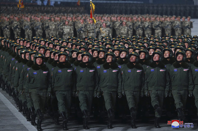 In this photo provided by the North Korean government, North Korean soldiers march in formation during a military parade marking the ruling party congress, at Kim Il Sung Square in Pyongyang, North Korea Thursday, January 14, 2021. North Korea rolled out developmental ballistic missiles designed to be launched from submarines and other military hardware in a parade that punctuated leader Kim Jong Un's defiant calls to expand his nuclear weapons program. Independent journalists were not given access to cover the event depicted in this image distributed by the North Korean government. (Photo by Korean Central News Agency/Korea News Service via AP Photo)