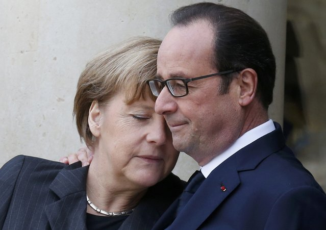 French President Francois Hollande (R) welcomes Germany's Chancellor Angela Merkel as she arrives at the Elysee Palace before the solidarity march (Rassemblement Republicain) in the streets of Paris January 11, 2015. (Photo by Pascal Rossignol/Reuters)