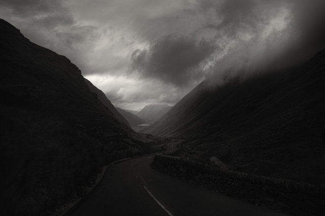 A dark morning road in the Lake District. (Photo by Andy Lee/Caters News)
