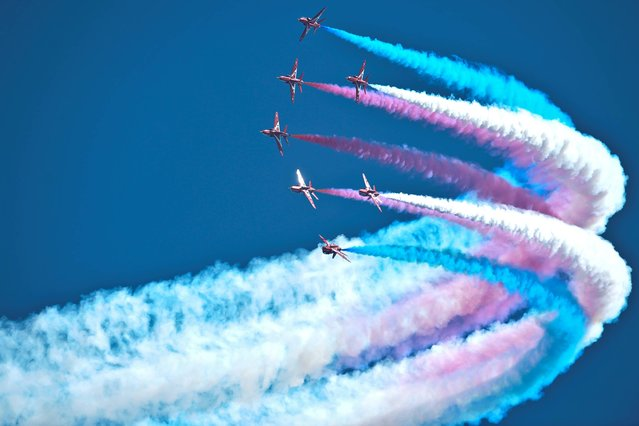 The Royal Air Force Red Arrows Display Team perform at RAF Fairford, Wiltshire, ahead of the Royal International Air Tattoo July 19, 2013. (Photo by Ben Birchall/PA Wire)
