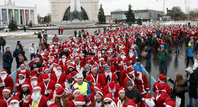 People dressed as Santa Claus and Father Frost, the Russian equivalent, and other characters take part in a charity race on the grounds of the Exhibition of Achievements of National Economy (VDNH) in Moscow, Russia, December 20, 2015. (Photo by Maxim Zmeyev/Reuters)