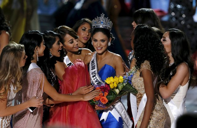Miss Philippines Pia Alonzo Wurtzbach (C) is surrounded by contestants after being crowned Miss Universe at the 2015 Miss Universe Pageant in Las Vegas, Nevada December 20, 2015. (Photo by Steve Marcus/Reuters)