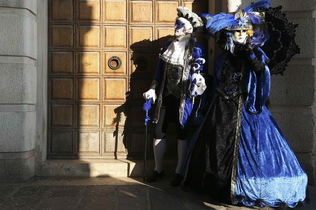 Masked revellers pose at Saint Mark's square during Carnival in Venice, February 8, 2015. (Photo by Stefano Rellandini/Reuters)