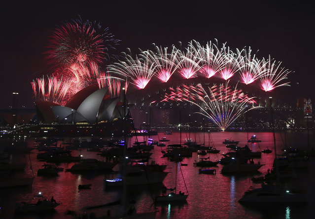 Fireworks explode over the Opera House and Harbour Bridge during New Year's Eve fireworks display  in Sydney, Australian, Friday, January 1, 2016. (Photo by Rob Griffith/AP Photo)