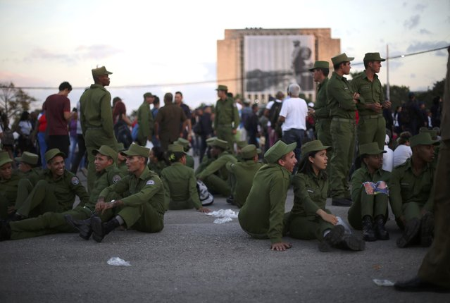 Soldiers wait to participate in a massive tribute to Cuba's late President Fidel Castro at Revolution Square in Havana, Cuba, November 29, 2016. (Photo by Edgard Garrido/Reuters)