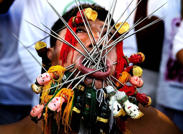 A devotee gest pierced at the Bang Neow shrine in Phuket. (Photo by Paula Bronstein/Getty Images)
