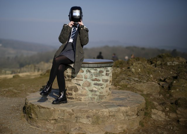 A girl uses a welding mask to view a partial solar eclipse from Bradgate Park in Newtown Linford, central England March 20, 2015. (Photo by Darren Staples/Reuters)