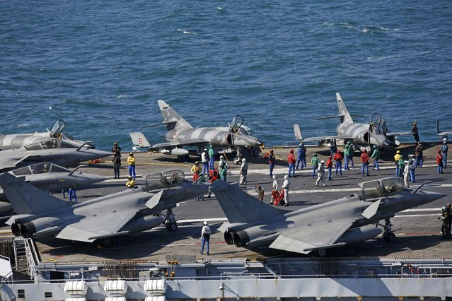 Rafale fighter jets and Super Etendards are seen aboard France's Charles de Gaulle aircraft carrier as it continues its mission in the Gulf, January 28, 2016. (Photo by Philippe Wojazer/Reuters)