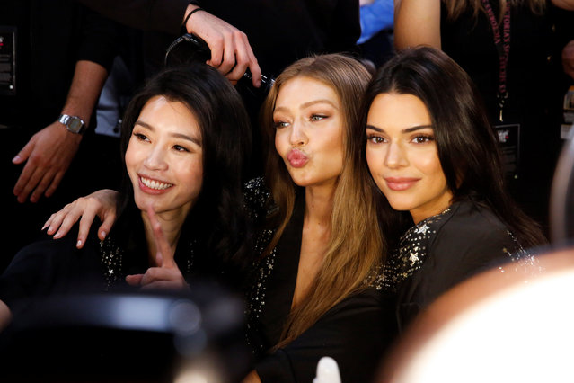 Liu Wen, Gigi Hadid, and Kendall Jenner pose for pictures backstage during the Victoria's Secret fashion show in the Manhattan borough of New York City, U.S., November 8, 2018. (Photo by Caitlin Ochs/Reuters)