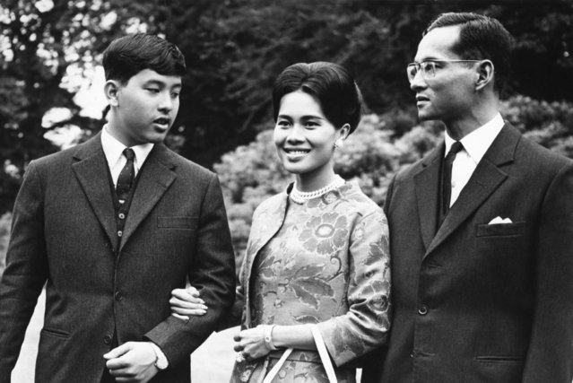In this July 27, 1966, file photo, Thailand's King Bhumibol Adulyadej, right, walks with Queen Sirikit and their 13-year-old son, Crown Prince Vajiralongkorn, through the gardens of their residence at Sunninghill, Berkshire, where they are staying during their private visit to Britain. Thailand's Royal Palace said on Thursday, Oct. 13, 2016, that King Bhumibol, the world's longest-reigning monarch, has died at age 88. (Photo by AP Photo/Harris)