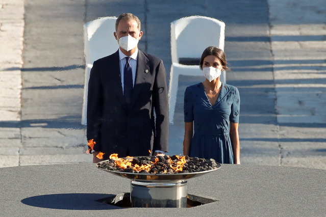 Spain's King Felipe, left and Queen Letizia participate in a ceremony to honour the victims of COVID-19 and the health workers at the Royal Palace in Madrid, Thursday, July 15, 2021. (Photo by Javier Lizon/Pool Photo via AP Photo)