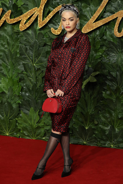 British singer Rita Ora poses on the red carpet upon arrival to attend the British Fashion Awards 2018 in London on December 10, 2018. (Photo by Daniel Leal-Olivas/AFP Photo)