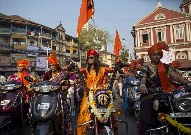 Maharashtrian women dressed in traditional costumes attend celebrations to mark the Gudi Padwa festival in Mumbai March 21, 2015. The festival marks the beginning of the new year for Maharashtrians and is celebrated widely in Maharashtra and in the Konkan region. (Photo by Danish Siddiqui/Reuters)