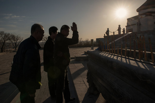 Visitors to a temple dedicated to Genghis Khan burn incense sticks as an offering to the Mongol hero. (Photo by Gilles Sabrie/The Washington Post)