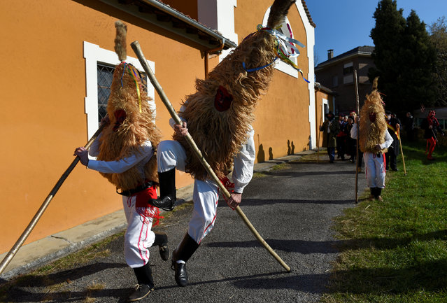 """Villagers jump during """"Los Sidros y Las Comedias"""", a traditional festival in Spain's northern village of Valdesoto, January 8, 2017. (Photo by Eloy Alonso/Reuters)"""