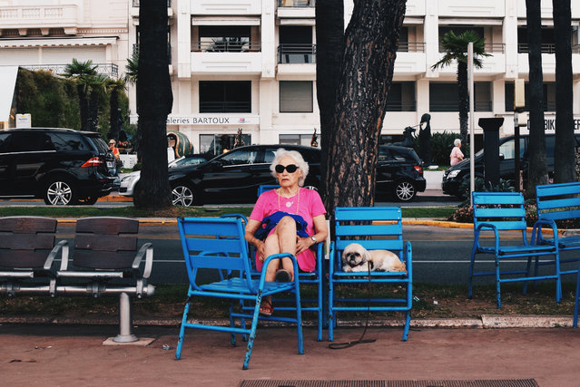 """Talia Rudofsky, UK. Youth Competition; Portraiture. """"I took this photograph on Promenade de la Croisette in Cannes during my summer holiday in 2015. This woman stood out among all the nouveau riche, as she is relatively modest in appearance, and accompanied by a dog. I found it amusing how the woman shared the same facial expression as the dog"""". (Photo by Talia Rudofsky/Sony World Photography Awards)"""