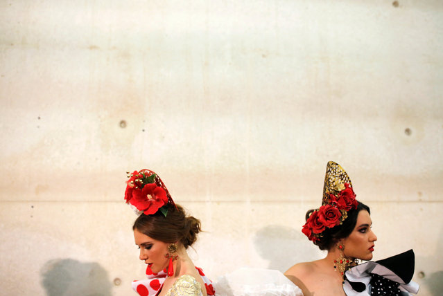 Models wearing creations by Alvaro Baturone on the backstage, during the International Flamenco Fashion Show SIMOF in the Andalusian capital of Seville, Spain February 8, 2019. (Photo by Marcelo del Pozo/Reuters)