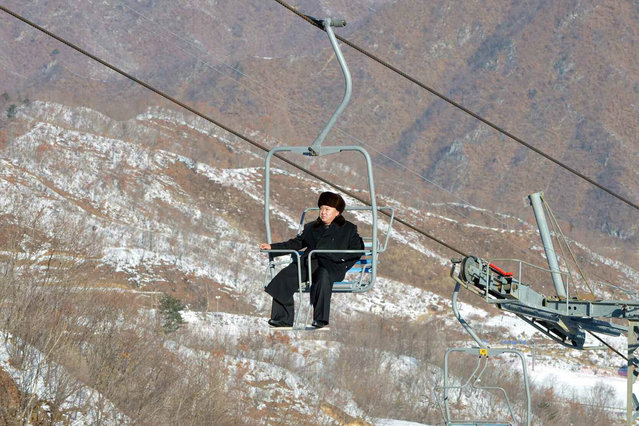 An undated handout picture made available by the Pyongyang's Rodong Sinmun on 31 December 2013, shows North Korean leader Kim Jong-un aboard a ski lift during his inspection tour at the Masik Pass ski resort, near Wonsan, North Korea. (Photo by Rodong Sinmun/EPA)