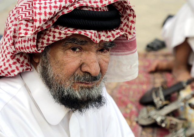 In this April 16, 2015 photo, Misfer al-Qahtani, a 70 year-old retired National Guard officer chats with friends at al-Aqeeliya open-air auction market in Riyadh, Saudi Arabia. (Photo by Hasan Jamali/AP Photo)