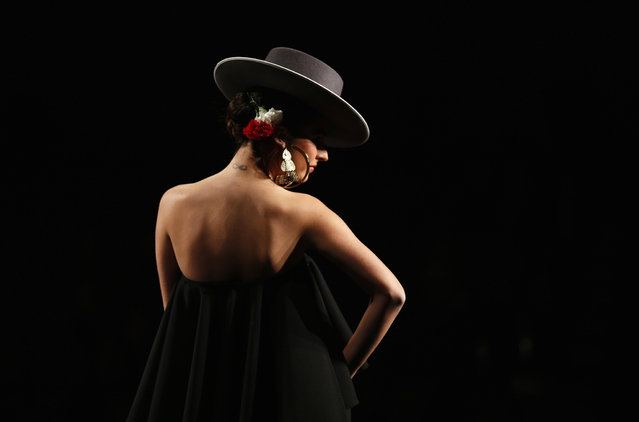 A model presents a creation by Carmen G. Vazquez during the International Flamenco Fashion Show SIMOF in the Andalusian capital of Seville January 30, 2014. The show will run until February 2. (Photo by Marcelo del Pozo/Reuters)