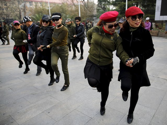 Women perform square dancing at a park square in Beijing, China, April 9, 2015. (Photo by Kim Kyung-Hoon/Reuters)