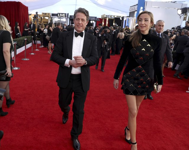 Hugh Grant, left, and Anna Elisabet Eberstein arrive at the 23rd annual Screen Actors Guild Awards at the Shrine Auditorium & Expo Hall on Sunday, January 29, 2017, in Los Angeles. (Photo by Matt Sayles/Invision/AP Photo)