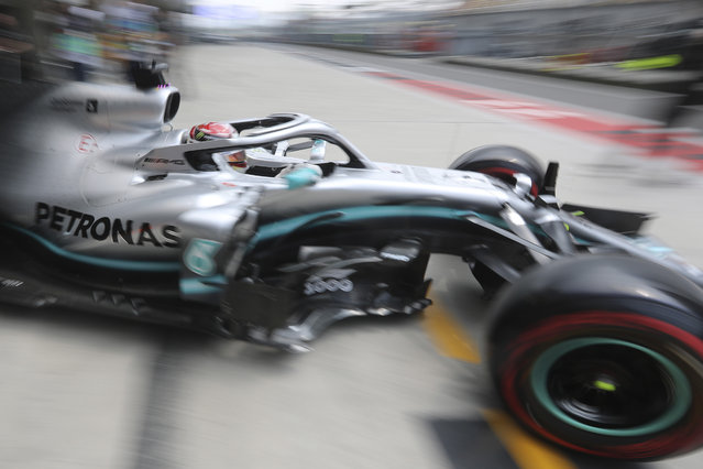 Mercedes driver Lewis Hamilton of Britain steers out of the garage during the first practice session of the Chinese Formula One Grand Prix at the Shanghai International Circuit in Shanghai on Friday, April 12, 2019. (Photo by Ng Han Guan/AP Photo)