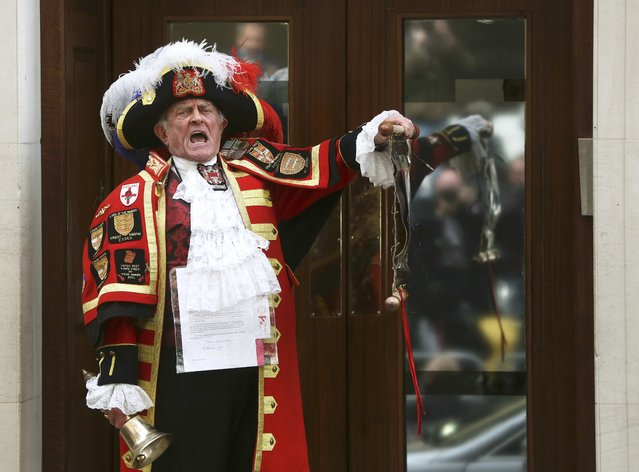 A ceremonial town crier announces the birth of a baby girl to royal fans and members of the media outside the entrance to the Lindo wing of St Mary's Hospital in London, Britain May 2, 2015. Britain's Catherine, Duchess of Cambridge, the wife of Prince William, has given birth to a daughter, the couple's residence Kensington Palace announced on Saturday. (Photo by Neil Hall/Reuters)
