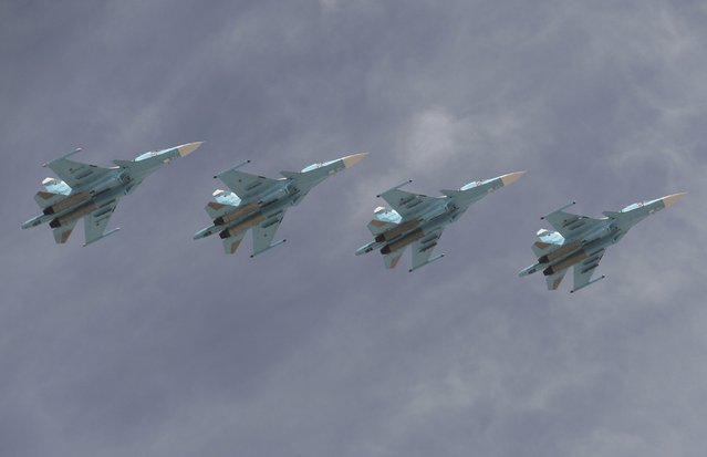 Sukhoi Su-34 Fullback tactical bombers fly in formation over the Red Square during the Victory Day parade in Moscow, Russia, May 9, 2015. (Photo by Reuters/Host Photo Agency/RIA Novosti)