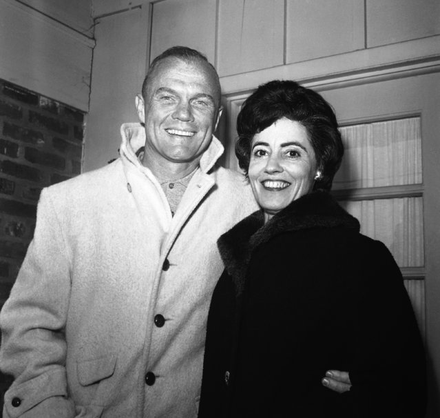 Astronaut John H. Glenn Jr. shown with his wife, Annie outside their Arlington, Va., home on February 3, 1962, during his first news conference. Glenn spent more than five hours in the Mercury capsule atop a rocket at Cape Canaveral, Florida a week ago only to have the shot postponed.  Glenn said he is anxious to get ahead with is orbit of the earth. (Photo by Bob Schutz/AP Photo)