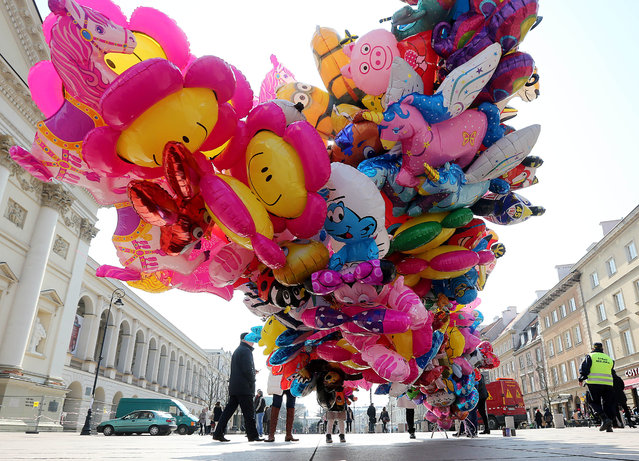 A street vendor sells balloons in the old town on Easter Monday in Warsaw, Poland, March 28, 2016. (Photo by Czarek Sokolowski/AP Photo)
