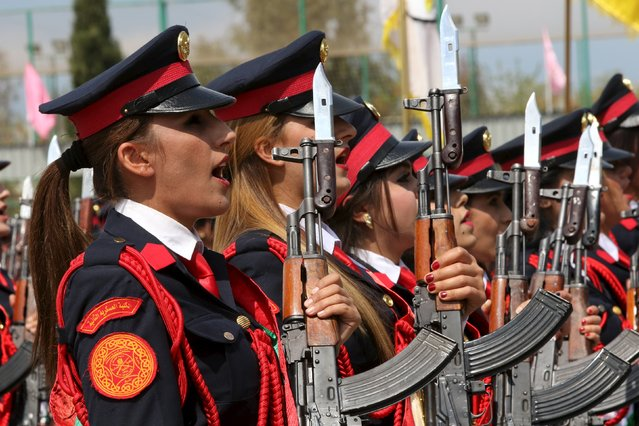 Female Kurdish Peshmerga take part their graduation ceremony at a police academy in Zakho district of the Dohuk Governorate of the Iraqi Kurdistan province, Iraq March 30, 2016. (Photo by Ari Jalal/Reuters)