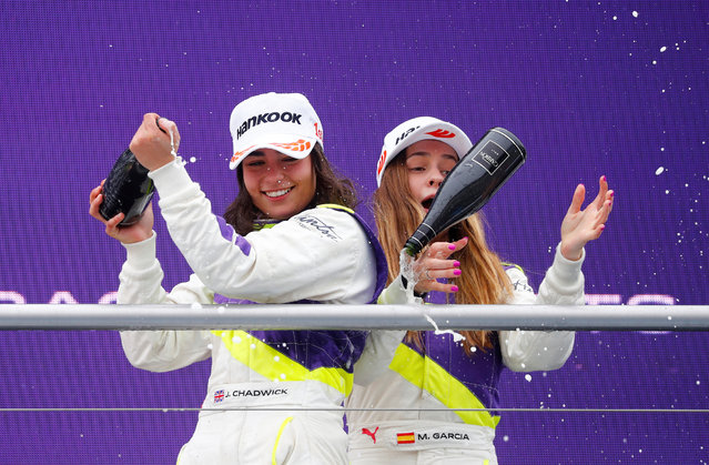 Marta Garcia (R) of Spain loses the champgane bottle standing on the podium next to winner Jamie Chadwick of Great Britain after the first race of the W Series at Hockenheimring on May 04, 2019 in Hockenheim, Germany. W Series aims to give female drivers an opportunity in motorsport that hasn't been available to them before. The first race of the series, which encompasses six rounds on the DTM support programme, is at the Hockenheimring on May 3rd and 4th. (Photo by Kai Pfaffenbach/Reuters)