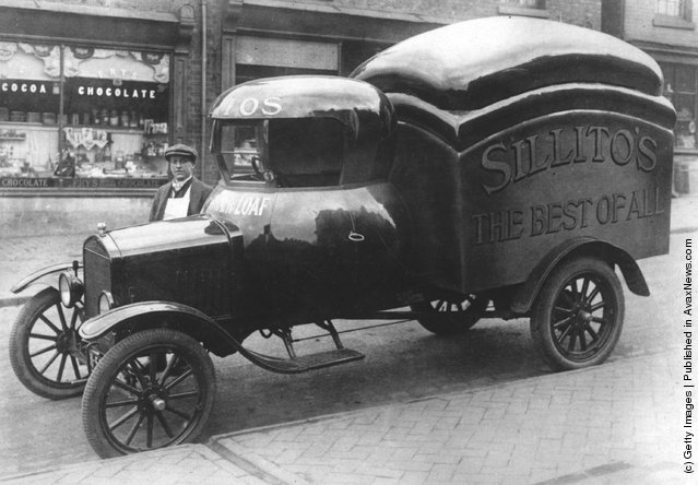 1925: Baker has constructed a delivery van with the driver's cab and the van in the shape of loaves of bread