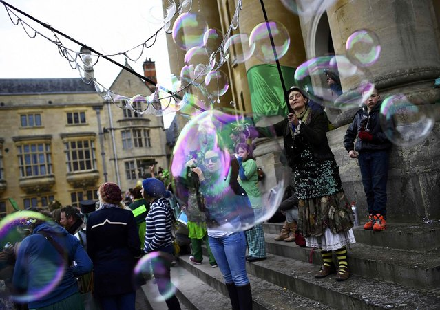 Revellers play with bubbles in the early hours during traditional May Day celebrations in Oxford, Britain, May 1, 2015. (Photo by Dylan Martinez/Reuters)