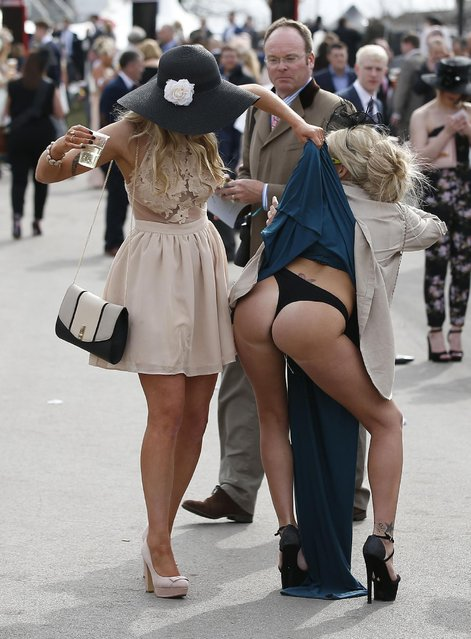 Ladies have fun during Ladies Day of the Crabbie's Grand National Festival at Aintree Racecourse on April 8, 2016 in Liverpool, England. (Photo by Andrew Yates/Reuters/Livepic)