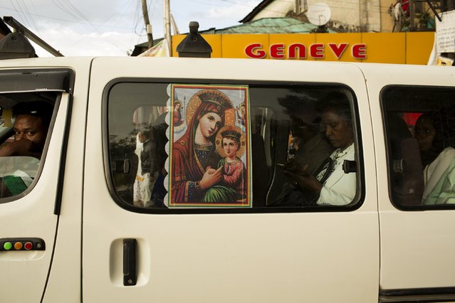 A poster depicting the Virgin Mary and her son Jesus Christ is seen on a window of a public transport minivan in Addis Ababa, Ethiopia, May 17, 2015. (Photo by Siegfried Modola/Reuters)