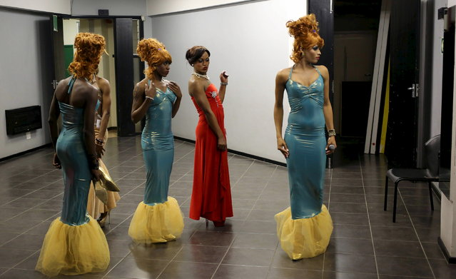 Contestants look at themselves in the mirror as they prepare backstage ahead of the Miss Gay Jozi (Jozi is slang for Johannesburg) pageant in Johannesburg, May 23, 2015. (Photo by Siphiwe Sibeko/Reuters)
