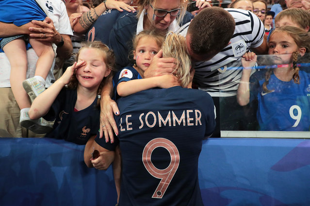 Eugenie Le Sommer (C) of France reacts with her family after losing the FIFA Women's World Cup 2019 quarter final soccer match between France and the USA in Paris, France, 28 June 2019. (Photo by Christophe Petit-Tesson/EPA/EFE)
