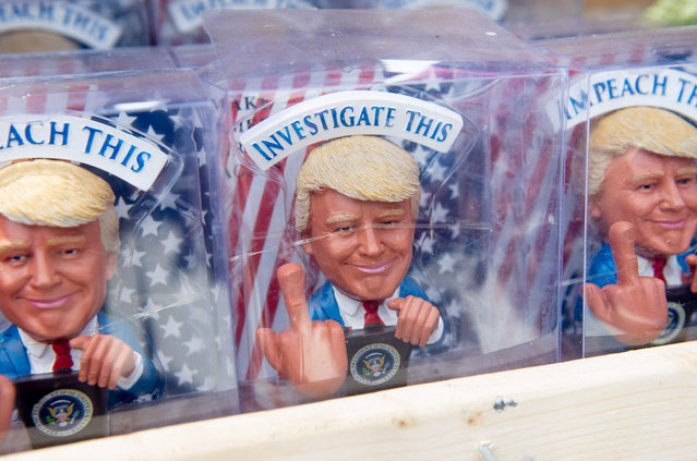 Figurines depicting US President Donald Trump are seen for sale along the National Mall in Washington, DC, July 4, 2019. (Photo by Saul Loeb/AFP Photo)