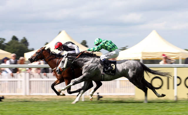 Free Eagle ridden by jockey Pat Smullen, left, comes home to win the Prince Of Wales's Stakes ahead of The Grey Gatsby during day two of the 2015 Royal Ascot Meeting at Ascot Racecourse, England, Wednesday June 17, 2015. (David Davies/PA via AP)UNITED KINGDOM OUT  NO SALES  NO ARCHIVE