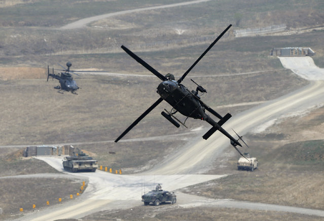 A U.S. army's OH-58D Kiowa Warrior helicopter takes part in a U.S.-South Korea joint live-fire military exercise at a training field in Pocheon, south of the demilitarized zone separating the two Koreas, April 11, 2014. The drill is part of Foal Eagle, an annual military training between U.S. and South Korea that runs from February 24 to April 18. (Photo by Kim Hong-Ji/Reuters)
