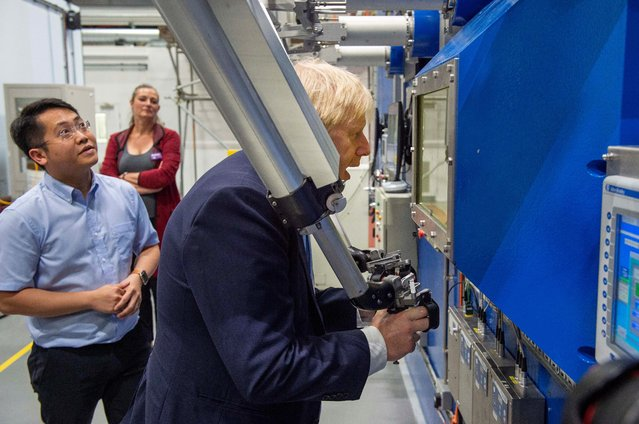 Britain's Prime Minister Boris Johnson visits the Fusion Energy Research Centre at the Fulham Science Centre in Oxfordshire, Britain August 8, 2019. (Photo by Julian Simmonds/Pool via Reuters)