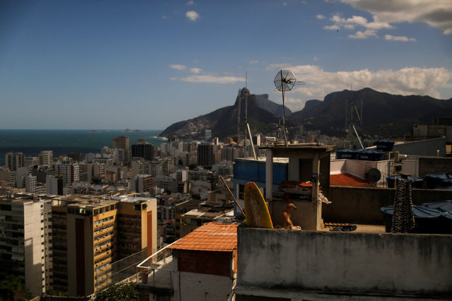 Dois Irmaos (Two brothers) peaks are seen from the Tiki hostel in Cantagalo favela, in Rio de Janeiro, Brazil, May 1, 2016. (Photo by Pilar Olivares/Reuters)