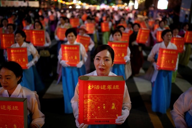 Buddhists carrying lanterns in the shape of a book march during a lotus lantern parade in celebration of the upcoming birthday of Buddha in Seoul, South Korea, May 7, 2016. (Photo by Kim Hong-Ji/Reuters)