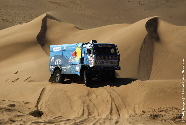 Ilgizar Mardeev of Russia drives his Kamaz truck over a sand dune during stage seven of the 2012 Dakar Rally