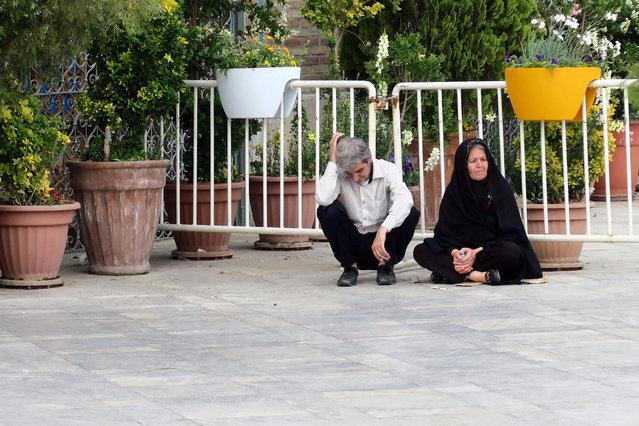 A man and a woman sit near the Imam Khomeini mosque, near Tehran's Grand Bazaar, Iran May 2, 2016. (Photo by Marius Bosch/Reuters)