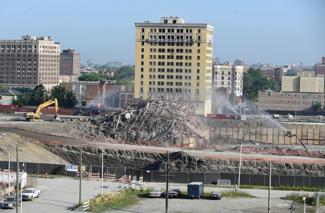 In this Saturday, July 11, 2015 photo, a pile of iron beams and concrete are all that remain of Detroit's Park Avenue Hotel after it was imploded to make way for a new hockey arena and entertainment district. (Photo by Max Ortiz/Detroit News via AP Photo)